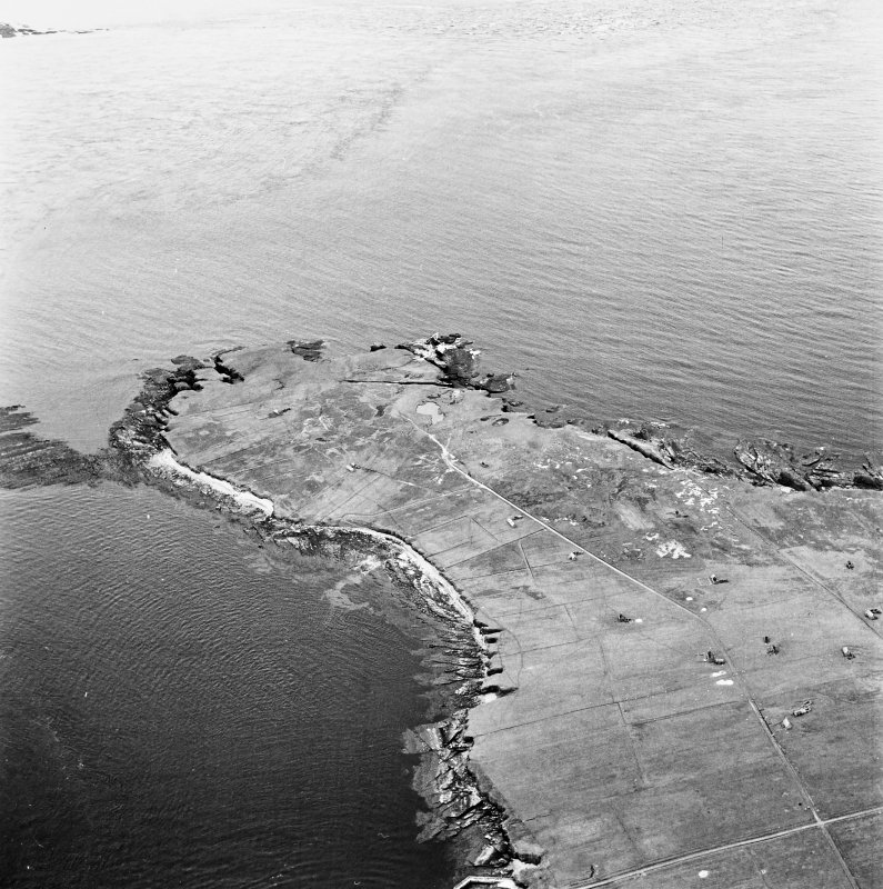 Stroma, oblique aerial view, taken from the ESE, centred on Mell Head and Uppertown township.