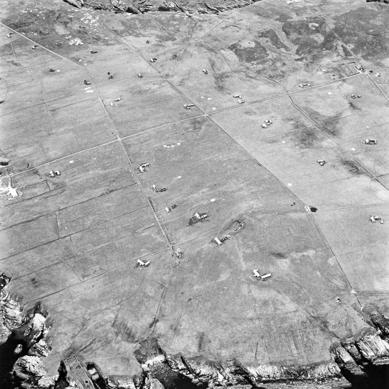 Stroma, oblique aerial view, taken from the E, centred on Uppertown township. A burial vault and dovecot are visible in the bottom left-hand corner of the photograph.