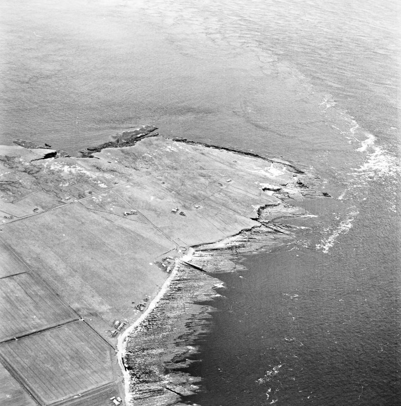 Stroma, oblique aerial view, taken from the ESE, showing Nethertown township in the centre of the photograph, and Stroma lighthouse in the centre right.