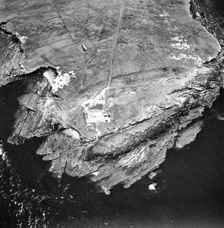 Stroma, oblique aerial view, taken from the N, centred on the lighthouse, and showing the edge of Nethertown township in the top half of the photograph.