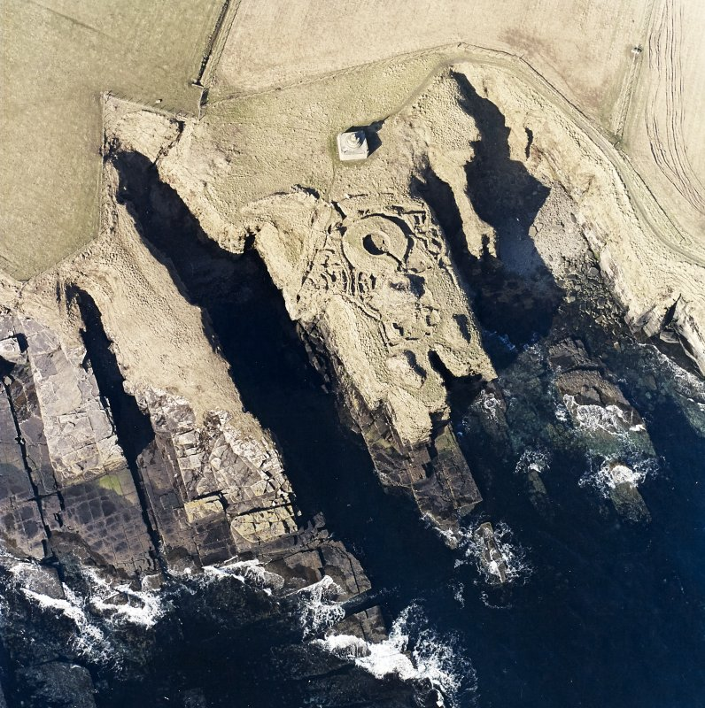 Oblique aerial view of the commemorative monument and the remains of the broch, taken from the E.