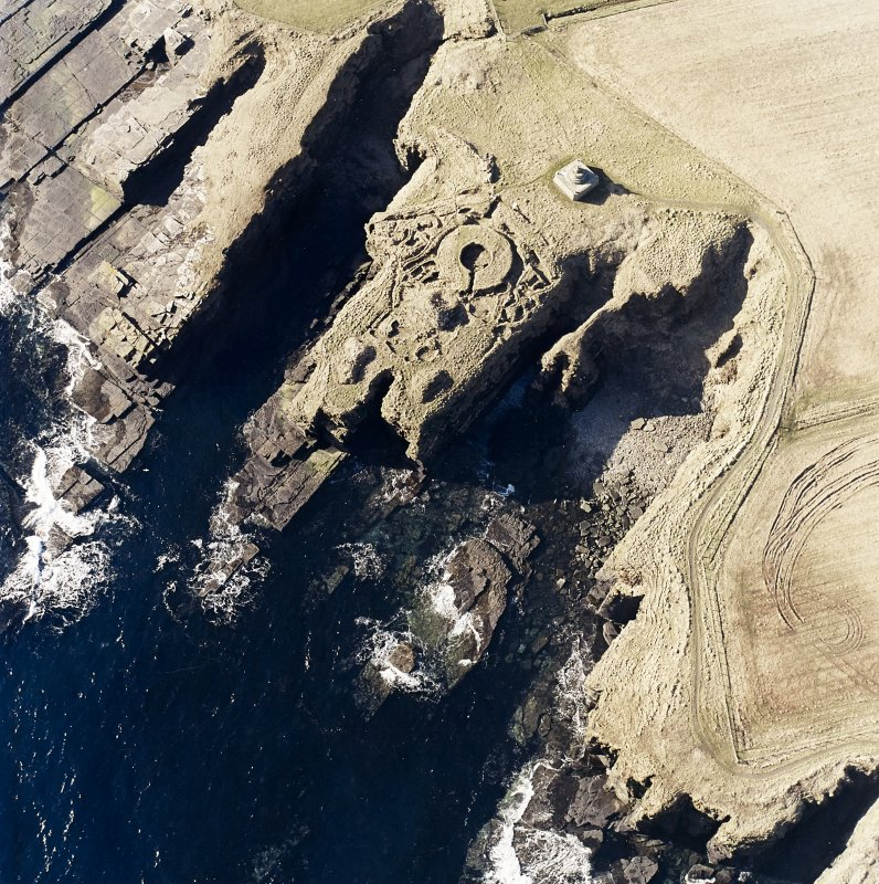 Oblique aerial view of the commemorative monument and the remains of the broch, taken from the NE.