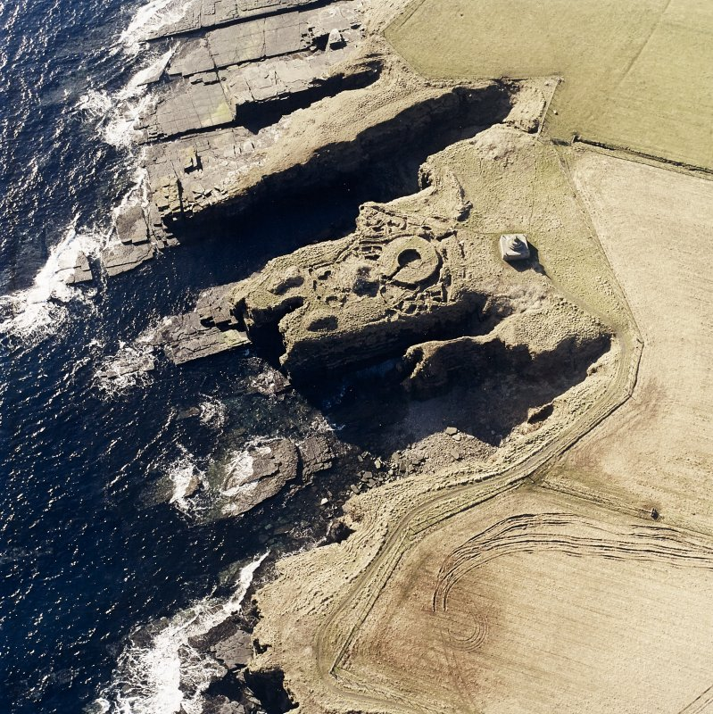 Oblique aerial view of the commemorative monument and the remains of the broch, taken from the N.