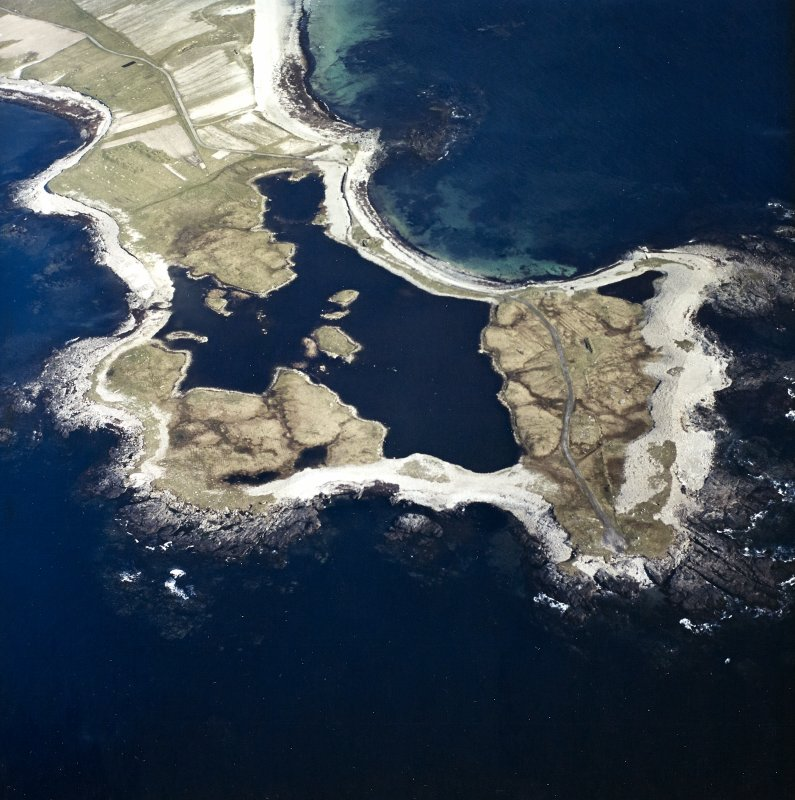 General oblique aerial view looking over Rubhe Ardvule, with the remains of the bothies, kelp kilns and the dun adjacent, taken from the NW.