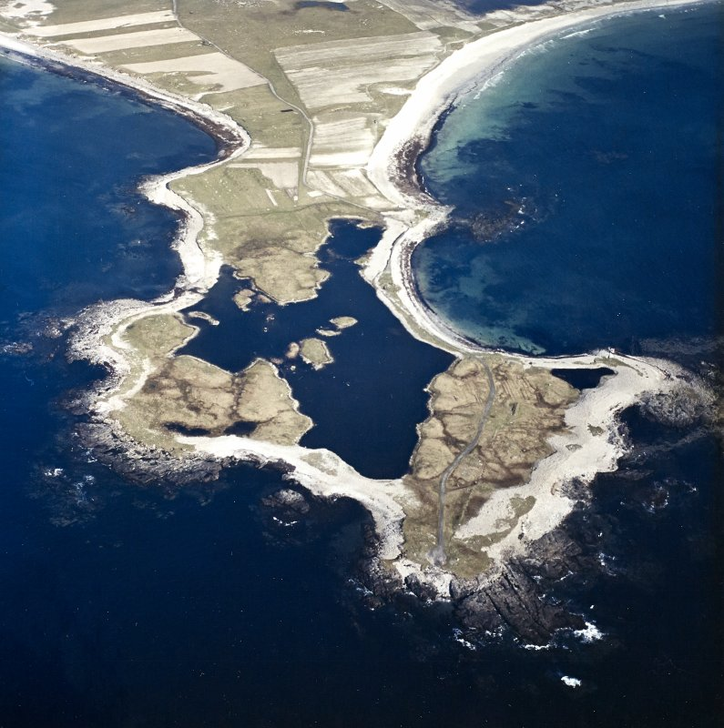 General oblique aerial view looking over Rubhe Ardvule, with the remains of the bothies, kelp kilns and the dun adjacent, taken from the WNW.