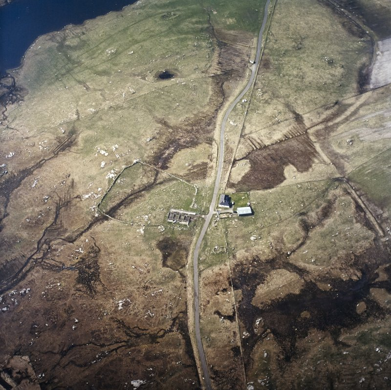 Oblique aerial view centred on the farmstead and the remains of the buildings, taken from the E.