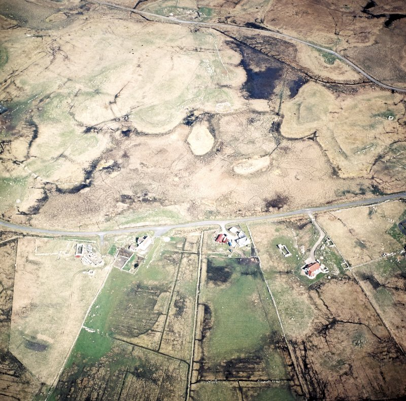 Oblique aerial view centred on the crofting township and the remains of the buildings, taken from the SW.