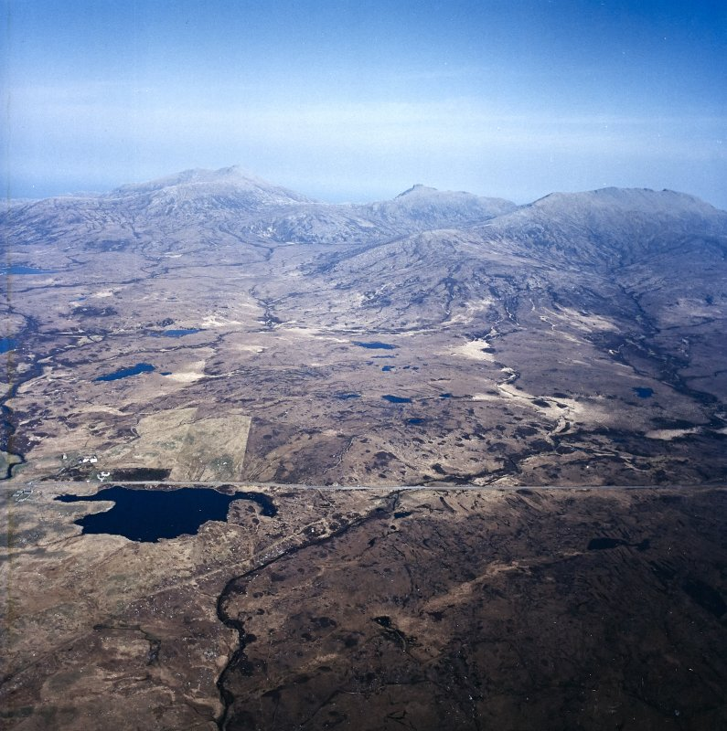 General oblique aerial view looking across South Uist towards Hecla and Beinn Mhor, taken from the W.