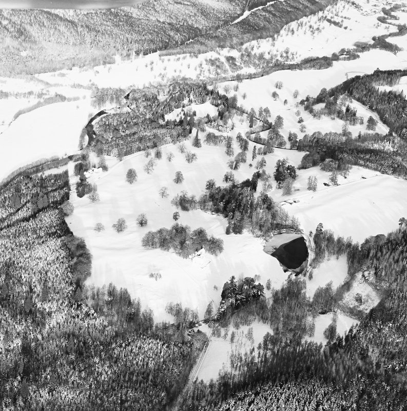 Oblique aerial view of Guisachan centred on Hilton Lodge with the remains of a country house in the background, taken from the SW.