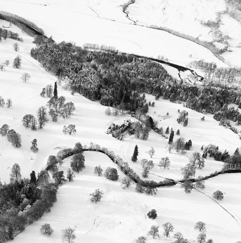 Oblique aerial view of Guisachan House centred on the remains of the country house, taken from the E.