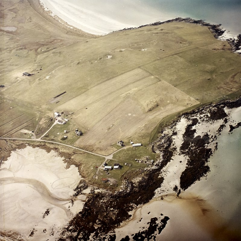 Oblique aerial view centred on the remains of the farmsteading, taken from the E.