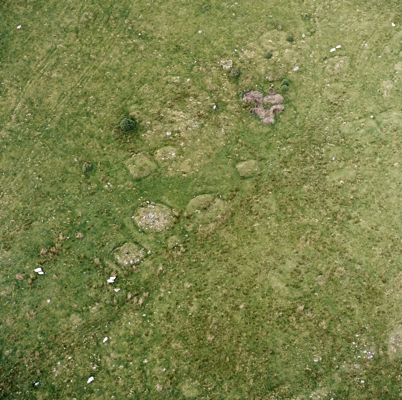Oblique aerial view of Garbeg centred on the remains of square and round barrows, taken from the SSE.