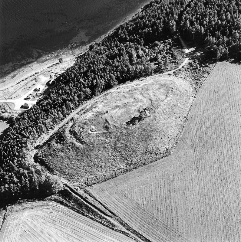 Oblique aerial view centred on the remains of the castle and the possible fort, taken from the NNW.