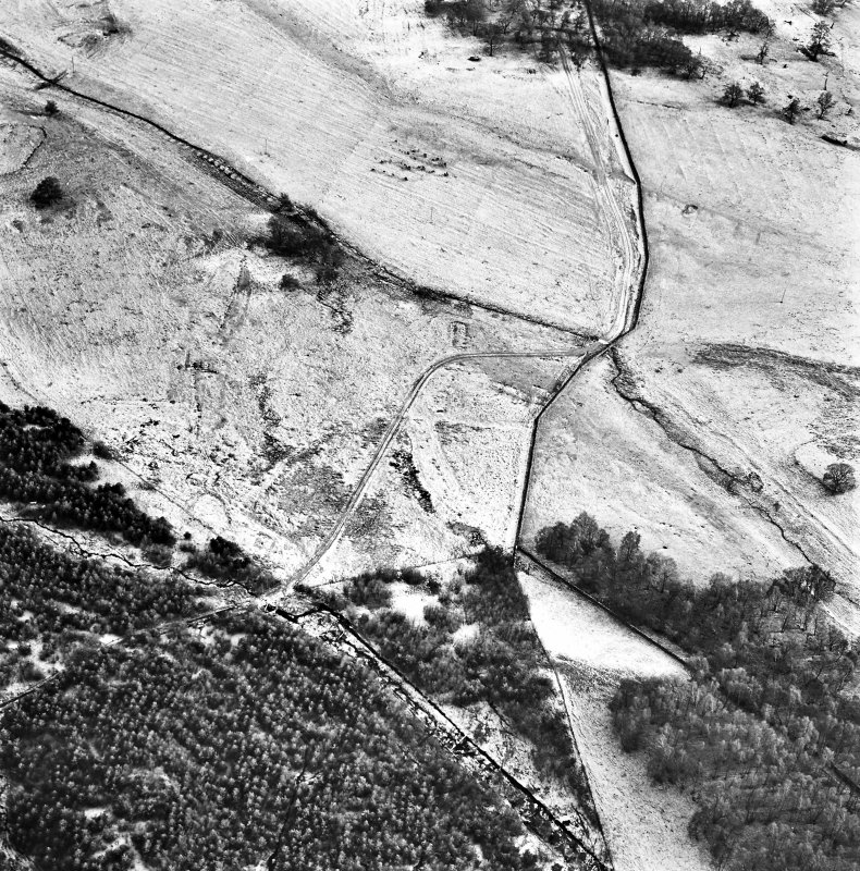Ballourie, oblique aerial view, taken from the NNW, showing the remains of a township and rig in the left half of the photograph, and another township and an enclosure in the right half.