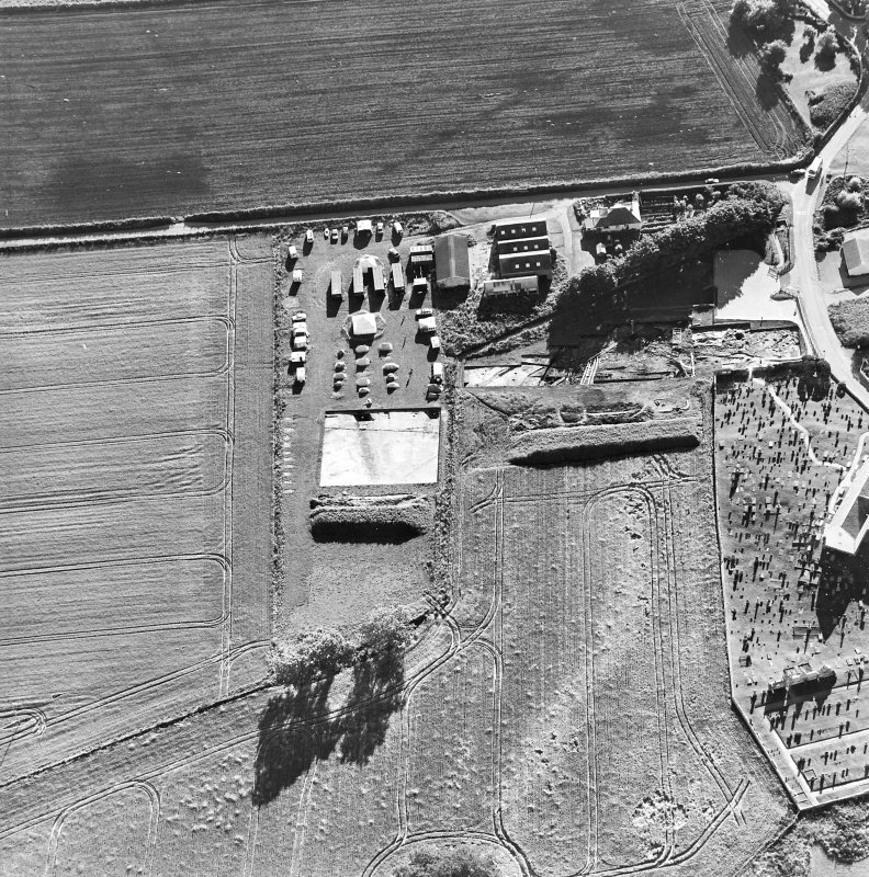 Oblique aerial view centred on the excavation with church and churchyard adjacent, taken from the ENE.