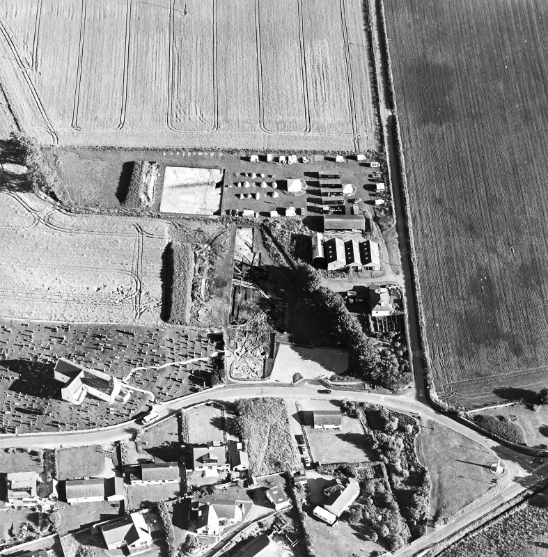 Oblique aerial view centred on the excavation with church and churchyard adjacent, taken from the NNW.