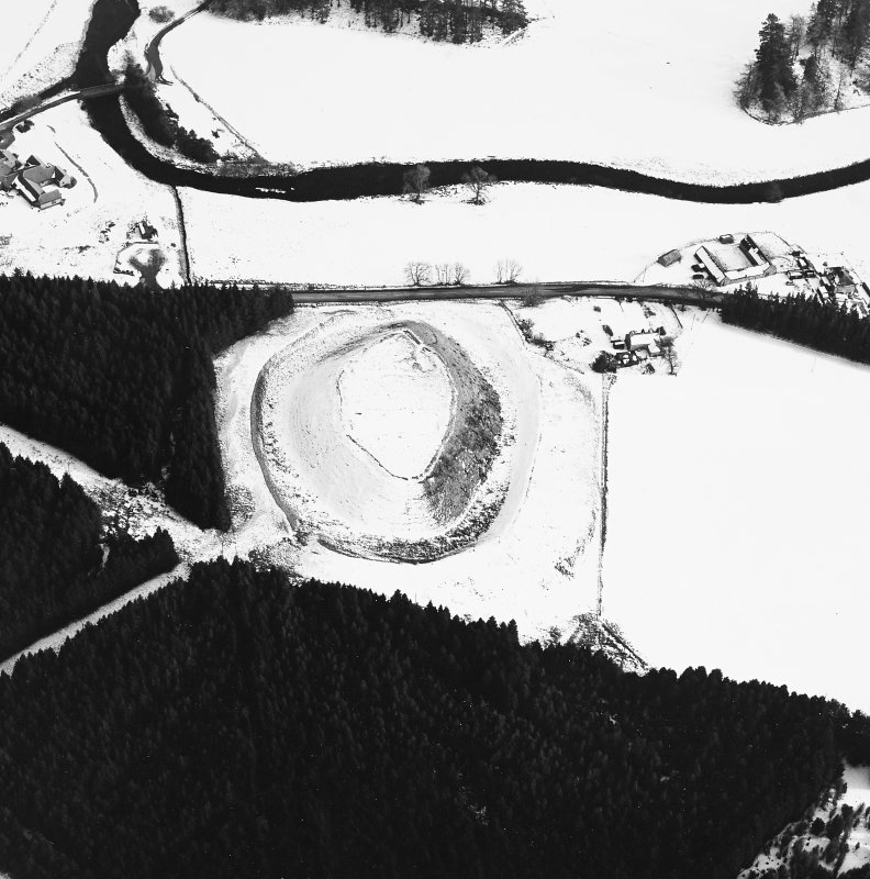 Oblique aerial view, taken from the WNW, of Doune of Invernochty Motte.