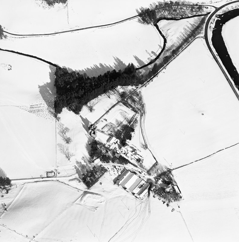 Oblique aerial view of Glenbuchat House centred on the country house, walled garden, farmsteading and the remains of a castle, taken from the SW.