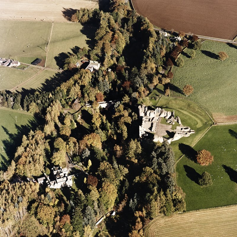 Oblique aerial view of Kildrummy castle centred on the remains of the castle with hotel adjacent, taken from the SW.