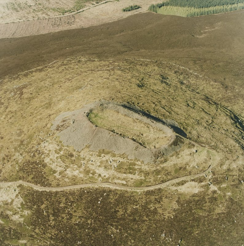 Oblique aerial view centred on the remains of the vitrified fort, taken from the S.