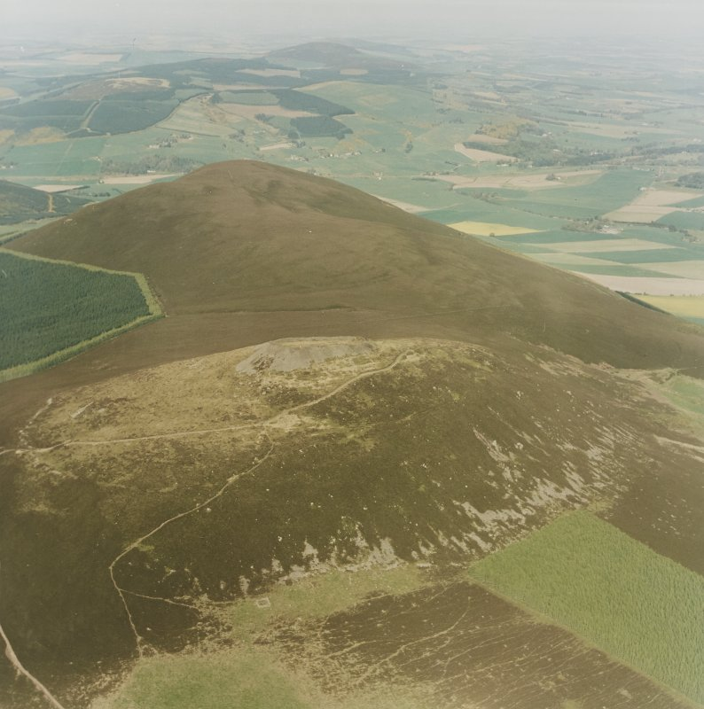 Oblique aerial view of Tap O' Noth vitrified fort, taken from the WSW.