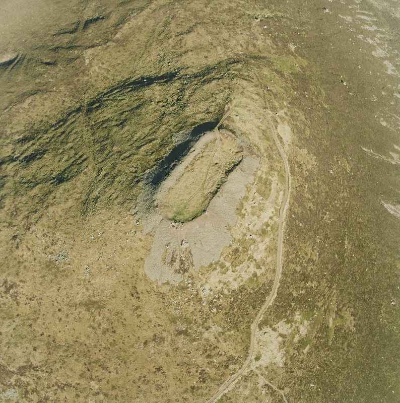 Oblique aerial view centred on the remains of the vitrified fort, taken from the WNW.