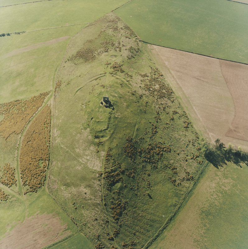 Oblique aerial view centred on the remains of the fort and rig, taken from the ESE.