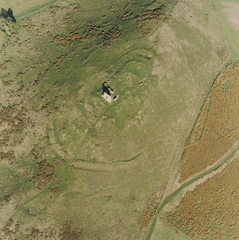 Oblique aerial view centred on the remains of the fort taken from the W.