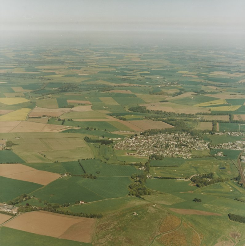 General oblique aerial view centred looking over the remains of the fort and village of Inch, taken from the W.