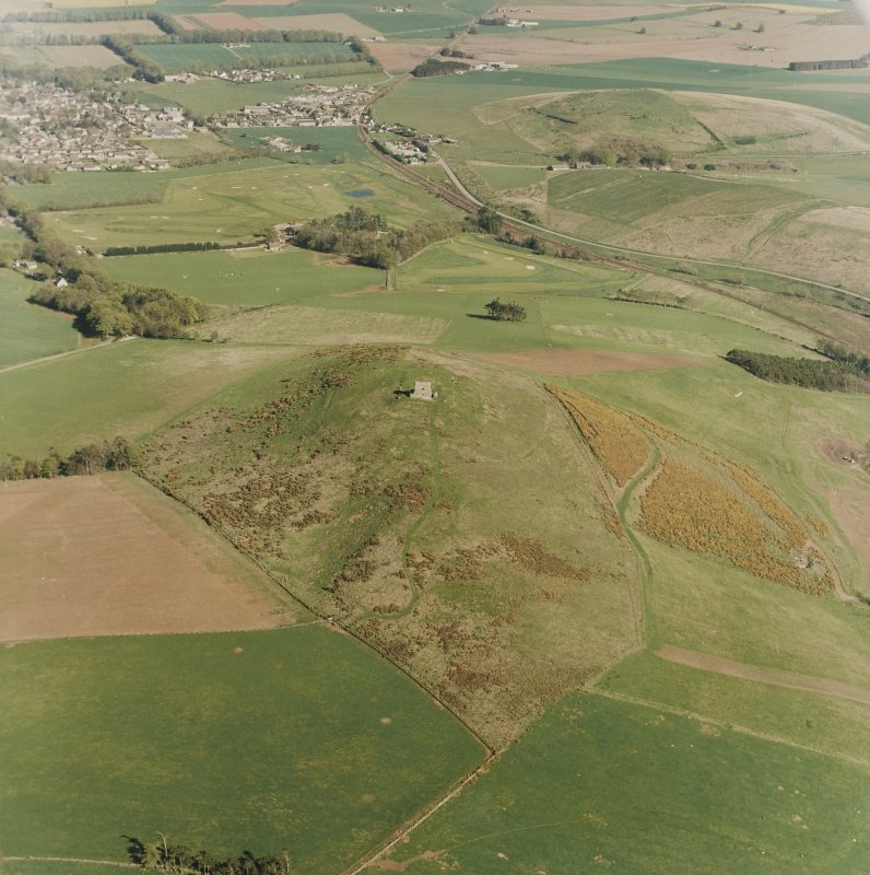 Oblique aerial view centred on the remains of the fort taken from the WNW.