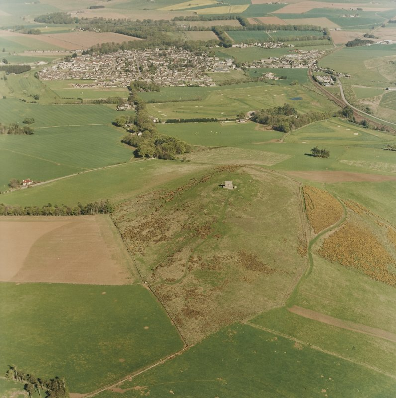 Oblique aerial view centred on the remains of the fort with village adjacent, taken from the WNW.