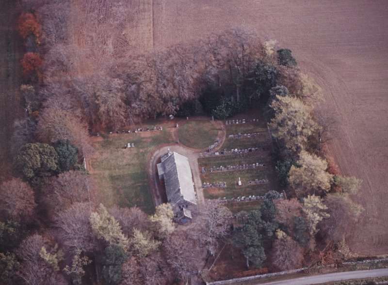 Oblique aerial view centred on the remains of the recumbent stone circle, the church and burial-ground, taken from the W.