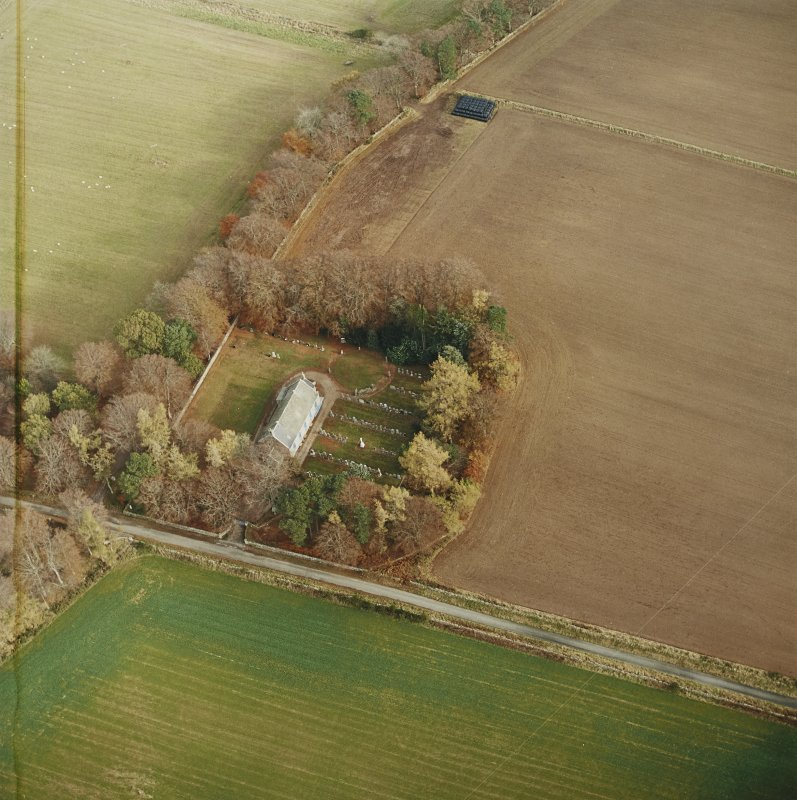 Oblique aerial view centred on the remains of the recumbent stone circle, the church and burial-ground, taken from the WSW.