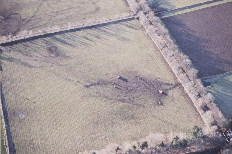 Oblique aerial view centred on the remains of the recumbent stone circle, taken from the E.