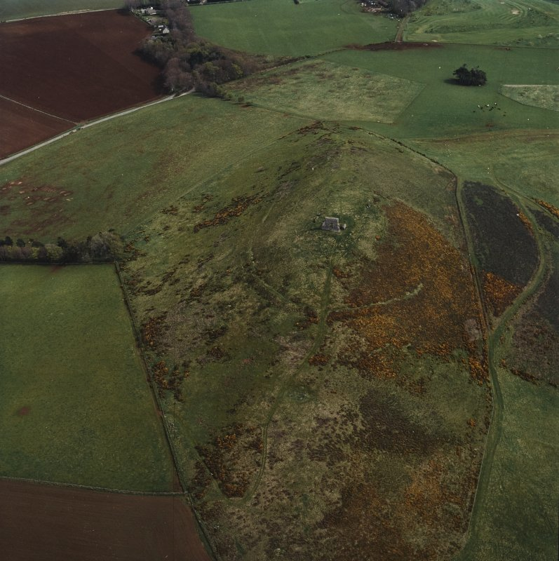 Oblique aerial view centred on the remains of the fort and tower-house, taken from the WNW.