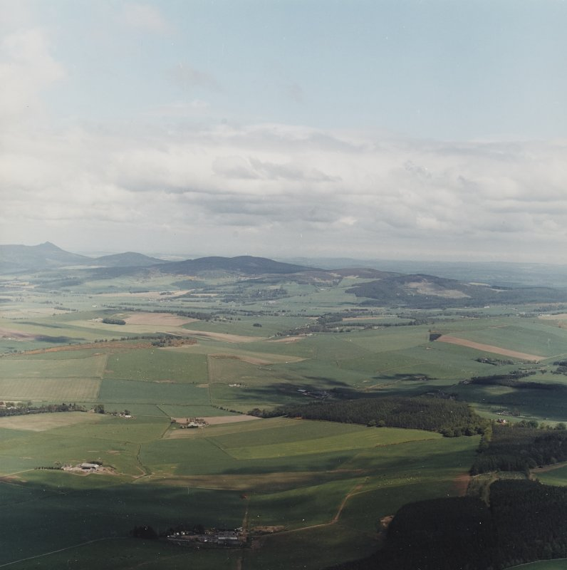 General oblique aerial view towards Bennachie, taken from the SW over the Howe of Alford.