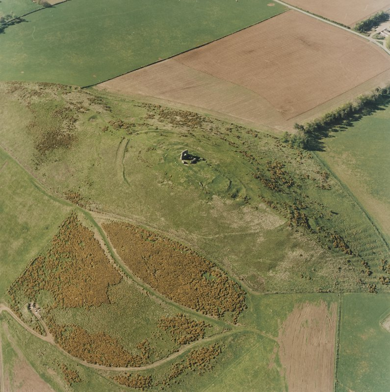Oblique aerial view centred on the remains of the fort and rig, taken from the SSE.