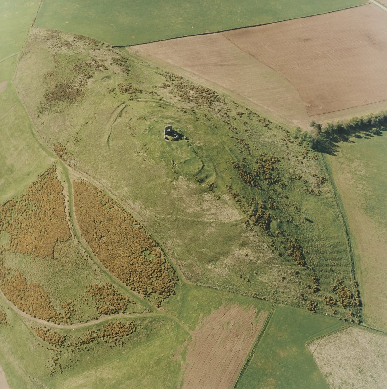 Oblique aerial view centred on the remains of the fort and rig, taken from the SE.