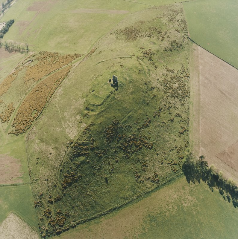 Oblique aerial view centred on the remains of the fort and rig, taken from the ENE.