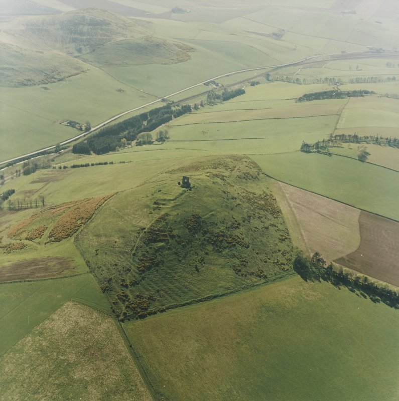 Oblique aerial view centred on the remains of the fort and rig, taken from the E.
