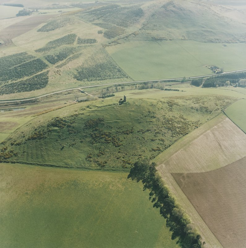 Oblique aerial view centred on the remains of the fort and rig, taken from the NE.