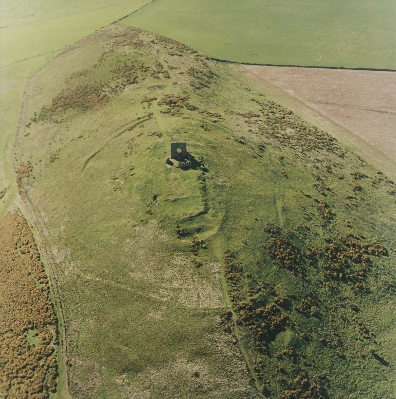 Oblique aerial view centred on the remains of the fort taken from the ESE.