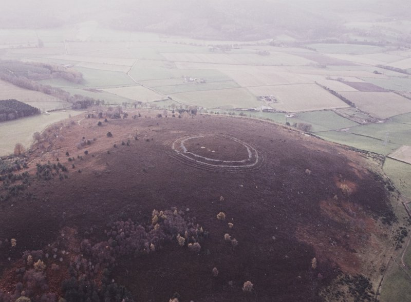 Oblique aerial view centred on the remains of the fort, taken from the NNE.
