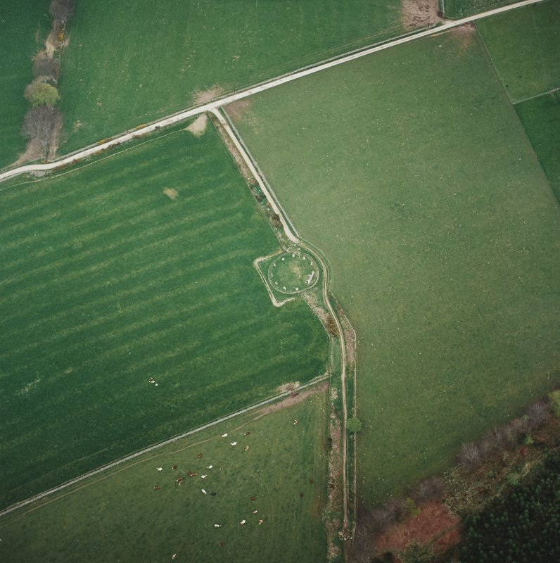 Oblique aerial view of the remains of the recumbent stone circle, taken from the W.