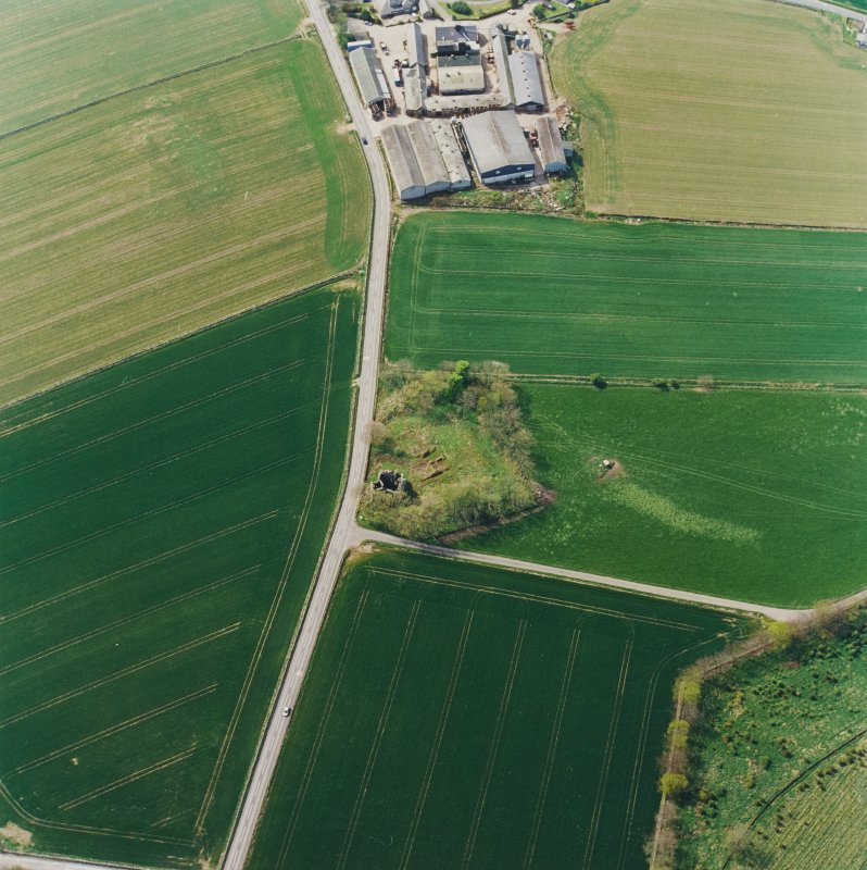 Oblique aerial view centred on the remains of the castle and tower-house, taken from the ENE.