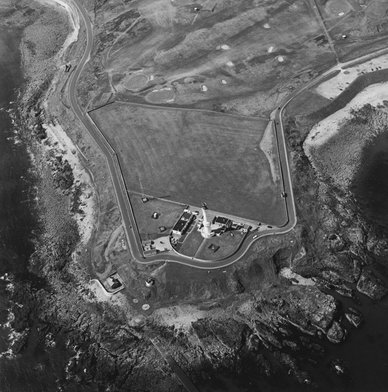 Oblique aerial view centred on the lighthouse with sewage works adjacent, taken from the E.