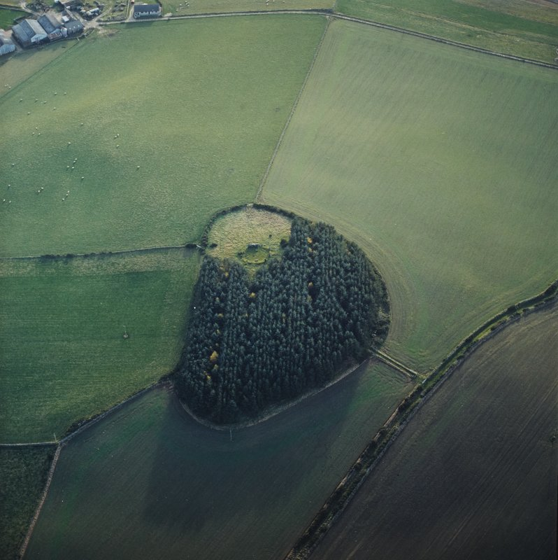 Oblique aerial view centred on the remains of the recumbent stone circle, taken from the NNE.