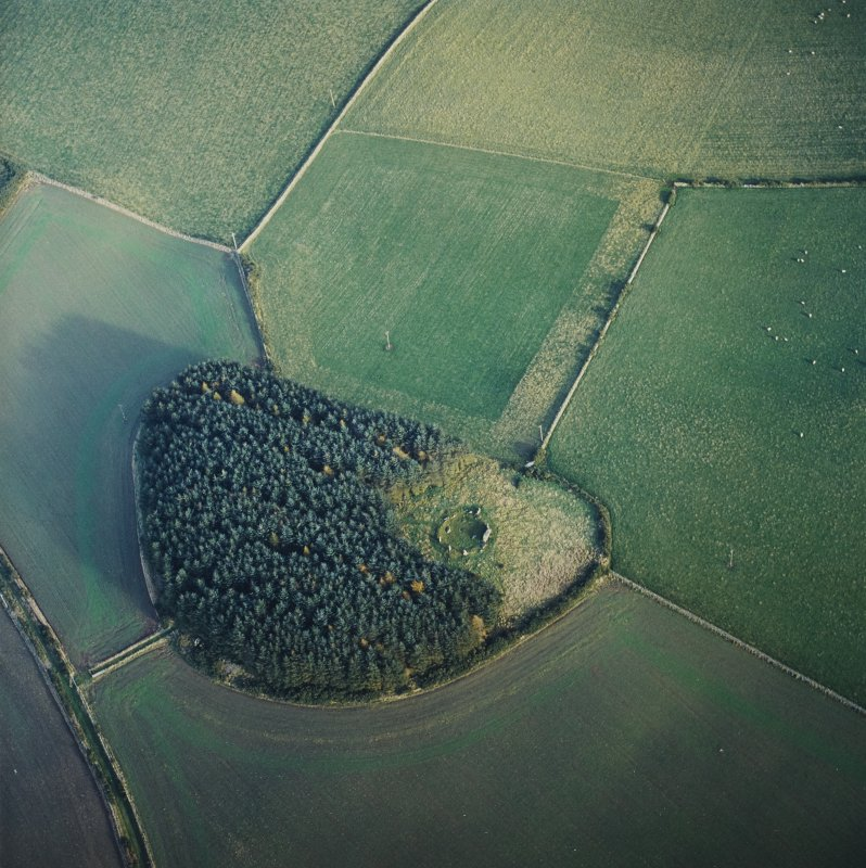 Oblique aerial view centred on the remains of the recumbent stone circle, taken from the WSW.