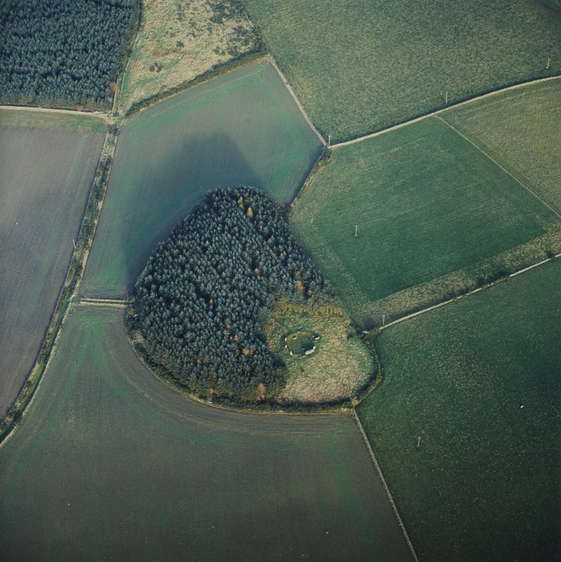 Oblique aerial view centred on the remains of the recumbent stone circle, taken from the SW.