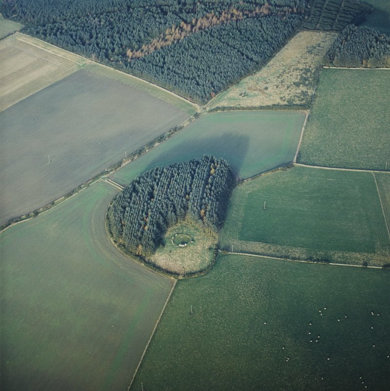 Oblique aerial view centred on the remains of the recumbent stone circle, taken from the S.